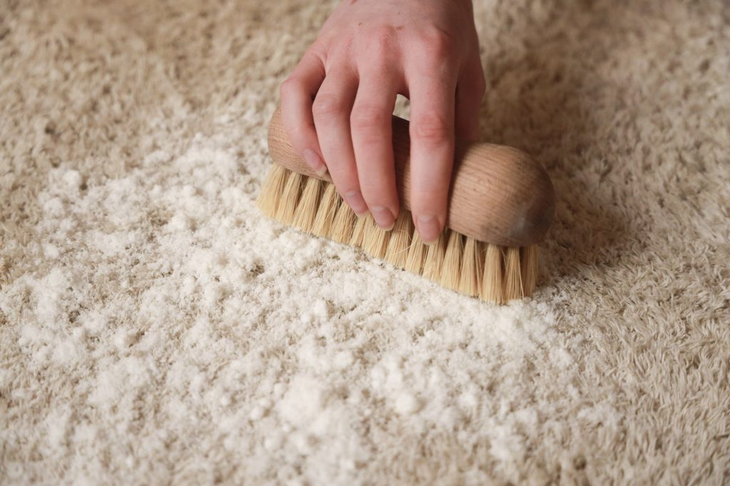 tapijt borstelen